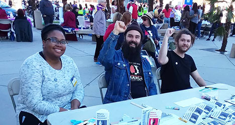 Jonny Miller and fellow Inland Empire Democratic Socialists of America at The IE Women's March 1-19-19